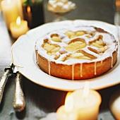 Iced apple cake; decoration: burning candles