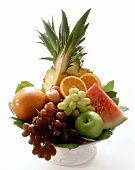 Fruit bowl with grapes, melon, pineapple etc.