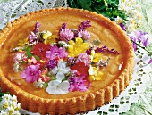 Sponge flan with edible flowers