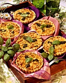 Leek tartlets with pine nuts and basil leaves