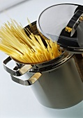 Spaghetti sticking out of a pasta pan