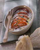 Tomato and mozzarella gratin with strips of basil