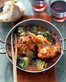 Braised rabbit with broccoli in tomato sauce