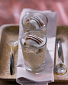 Cappuccino mousse with cream topping and cocoa in glass