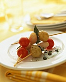 Potato and tomato kebabs with caper dip
