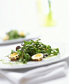 Rocket salad with herb sauce and quail's eggs