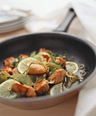 Pan-cooked chicken dish with green tomatoes and limes