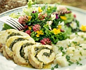 Turkey roulade with white asparagus and flower salad