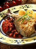 Grilled carp in bread coating, with tomato and olive sauce