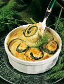 Courgette and fish roulade au gratin