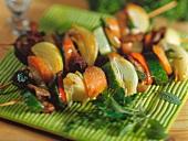 Grilled vegetable kebabs with sage leaves