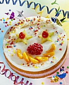 Clown cake with fruit and coloured sprinkles for children
