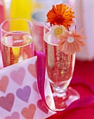 Two champagne glasses with summery birthday decorations