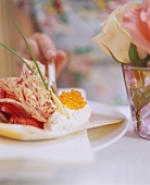 Woman tasting smoked salmon mousse on radicchio salad