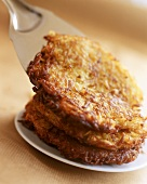 Potato rosti on plate and server