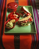 Tacos with mince filling; guacamole; salsa (Mexico)