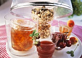 Various jams, honey and muesli in jars
