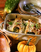 Cannelloni with pumpkin and spinach filling in baking dish