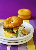 Fish burger with caper sauce and rocket