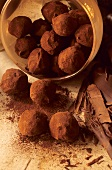 Chocolate truffles, some in box