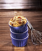 Small cod and bacon soufflé in blue baking dish