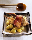 Quail with bacon, grapes and honey sauce