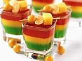 Jelly with skewered fruit in glasses