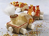 Train cake with marshmallows and gummi bears for children