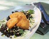 Breaded kohlrabi escalope on wild rice with herb sauce