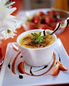 Crème brulee with woodruff and strawberries