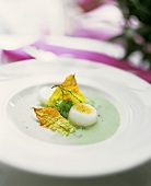 Chervil soup with quail's eggs