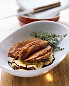Crispy duck breast on polenta with chocolate and chili syrup