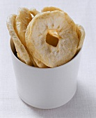 Dried apple rings in white bowl