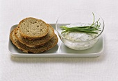 Herb quark and slices of bread