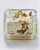 Marinated sheep's cheese in olive oil with rosemary & chili