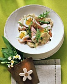 Sausage salad with egg and bread dumplings