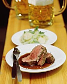 Ox fillet in red wine sauce; potato salad; beer