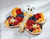Fruit cake in shape of a butterfly for child's birthday