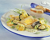 Fried plaice fillet with courgettes in dill sauce