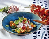 Pan-cooked potato and vegetable dish with ricotta
