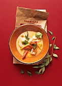 Coconut soup with shrimps and lemon leaves (Asia)