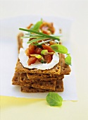 Rye crispbread with soft cheese and tomatoes