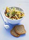 Sprout salad with nectarines & cashew nuts; wholemeal bread