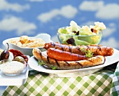 Grilled sausages with various accompaniments