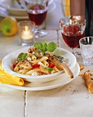 Penne with chicken, olives, tomatoes & mozzarella; red wine