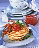 Hearty pancakes with bacon and tomato butter