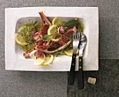 Raw lamb cutlets in spicy lemon and garlic marinade