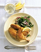Breaded poussin with parsley salad
