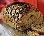 Wholemeal bread, slices cut; knife