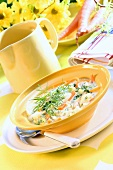 Cold dill soup with strips of carrot